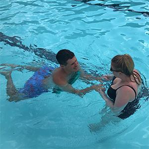 Summer camp special needs swim programs help children with swim